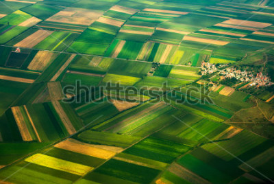 Fototapeta aerial photo from a plane, top view, field roads and city
