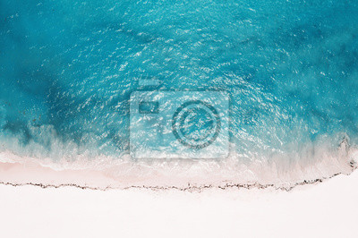 Fototapeta Aerial view from drone on tropical island with turquoise caribbean sea. Travel destination
