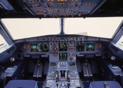 Fototapeta airplane cockpit of a modern passenger jet