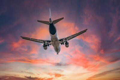 Fototapeta Airplane in the sky at sunrise
