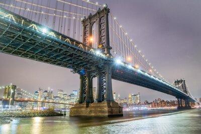 Fototapeta Amazing night view of Manhattan and Brooklyn Bridge at night, winter season, New York City