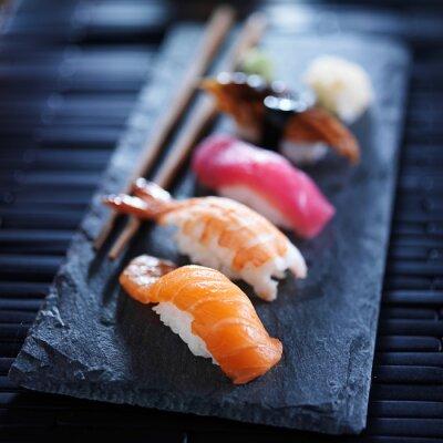 Fototapeta Assorted sushi nigiri na łupku