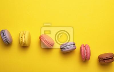 Fototapeta assortment of multi-colored baked round macarons