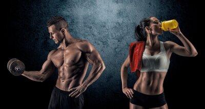 Fototapeta Athletic man and woman