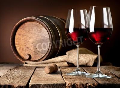 Fototapeta Barrel i kieliszki czerwonego wina na drewnianym stole