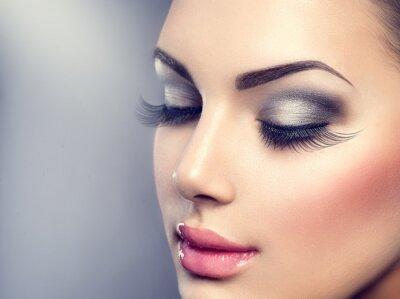 Fototapeta Beautiful fashion luxury makeup. Long eyelashes, perfect skin