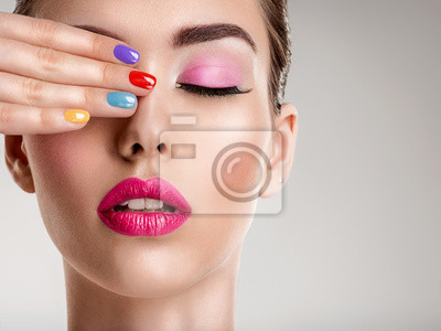 Fototapeta Beautiful fashion woman with a colored nails. Attractive white girl with multicolor manicure.