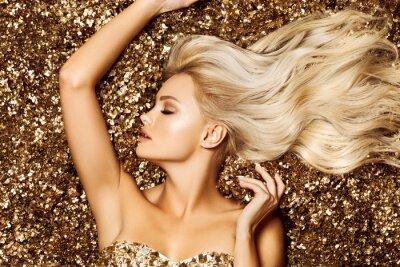 Fototapeta Beautiful hair Girl. Healthy Long Hair. Blonde woman in golden flowers garden, princes