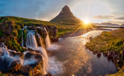 Fototapeta Beautiful landscape with sunrise on Kirkjufellsfoss waterfall and Kirkjufell mountain, Iceland, Europe.