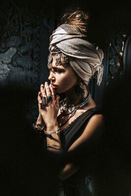 Fototapeta beautiful young stylish woman wearing turban outdoors portrait