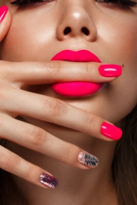 Fototapeta Beautiful young woman with bright makeup and neon pink nails. Beauty face. Photo taken in the studio
