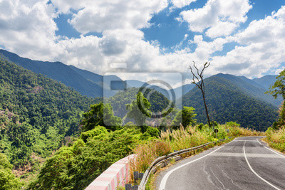 Fototapeta Bend of road and a view of the mountains around Da Lat city (Dal
