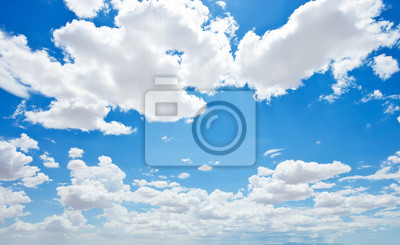 Fototapeta Białe puszyste chmury w błękitne niebo