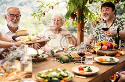Fototapeta Big family having dinner at the veranda