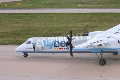 Fototapeta BIRMINGHAM, UK - APRIL 24, 2013: Pilots taxi Flybe Bombardier Dash 8 Q-400 at Birmingham Airport, UK. Flybe carried 7.6 million passengers in 2013.