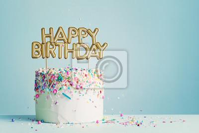 Fototapeta Birthday cake with happy birthday banner