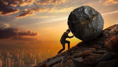 Fototapeta Biznes ludzi naciskając duży kamień aż do wzgórza, Biznes ciężkich zadań i koncepcji problemów.