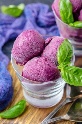 Fototapeta Blueberry ice cream with basil in glasses.