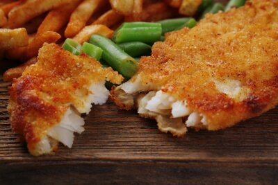 Fototapeta Breaded fried fish fillet and potatoes with asparagus
