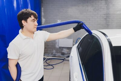 Fototapeta Car interior textile seats chemical cleaning with professionally extraction method. Early spring cleaning or regular clean up.