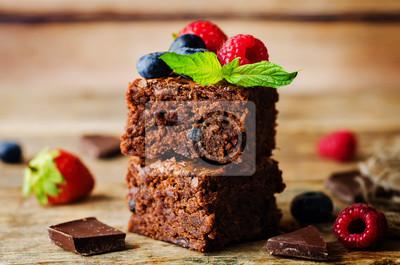 Fototapeta Chocolate brownie with berries and mint leaves