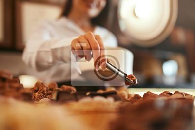 Fototapeta Chocolate Candies In Confectionery Store Closeup