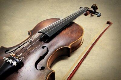 Fototapeta Classic violin on grunge paper texture.