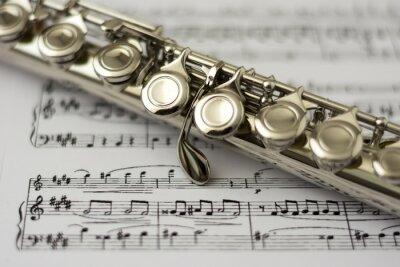 Fototapeta Close up flute on flute sheet music background