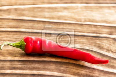 Fototapeta close-up on chili pepper with wooden background