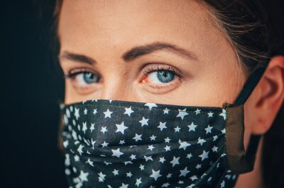 Fototapeta Close up woman portrait, Young woman wearing home made hygienic face medical mask to prevent infection, illness or flu and 2019-nCoV. Black background. Protection against disease, coronavirus.