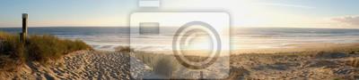 Fototapeta Coucher de soleil dans la presa de la dune de plage