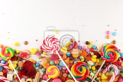 Fototapeta cukierki z galaretką i cukrem. kolorowy zestaw różnych słodyczy i smakołyków dla dzieci.