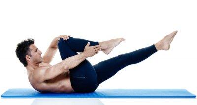 Fototapeta Ćwiczenia mężczyzna ćwiczeń pilates izolowane
