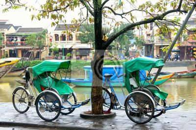 Fototapeta Cyclo w starożytnego miasta Hoi An, Wietnam. Cyclo jest farvourite transportu pojazdu turysty w Wietnamie