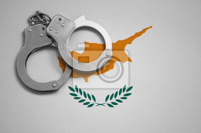 Fototapeta Cyprus flag  and police handcuffs. The concept of crime and offenses in the country