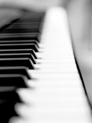 Fototapeta Czarny fortepian bliska rozmycie tła i pierwszego planu.