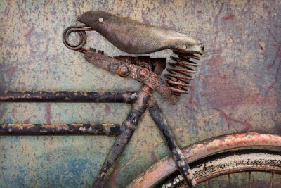 Fototapeta Detail of a rusted ancient bicycle with leather seat