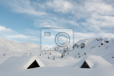 Fototapeta Domki górskie pokryte śniegiem