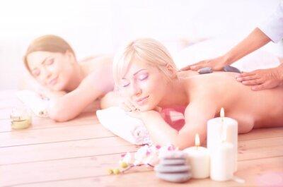 Fototapeta Two young beautiful women relaxing and enjoying at the spa. Two young beautiful women relaxing