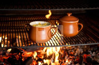 Fototapeta dzbany z jedzeniem na ogień