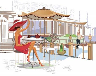 Fototapeta Dziewczyna picia kawy w kawiarni ulicznej