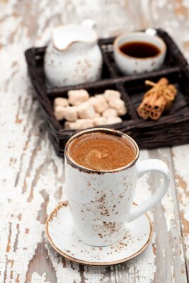 Fototapeta Filiżanka kawy cappuccino na jasnym tle.