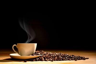 Fototapeta Filiżanka kawy z dymu i ziaren kawy na starym drewnianym tle