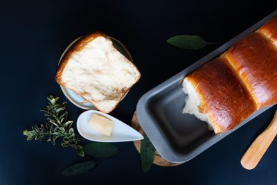 Fototapeta Food Baking concept Fresh baked organic homemade soft milk loaf bread in loaf pan with copy space