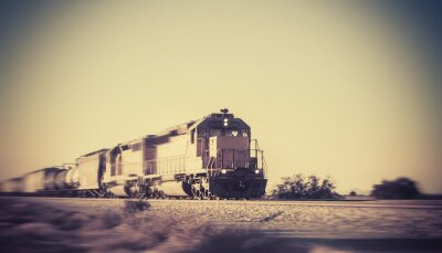 Fototapeta Freight train traveling through desert Arizona