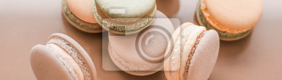 Fototapeta French macaroons on cream beige background, parisian chic cafe dessert, sweet food and cake macaron for luxury confectionery brand, holiday backdrop design