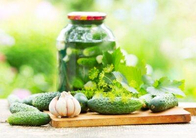 Fototapeta fresh and pickled cucumbers
