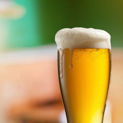 Fototapeta Glass of light beer in pub