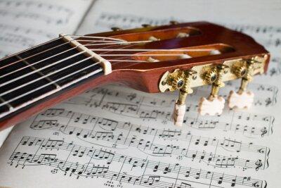 Fototapeta główka gitary na nuty