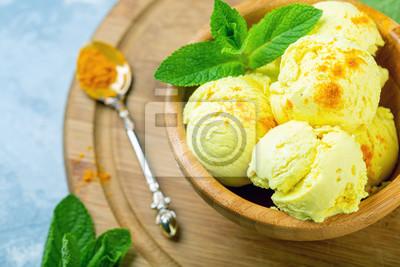 Fototapeta Golden ice cream with turmeric closeup.